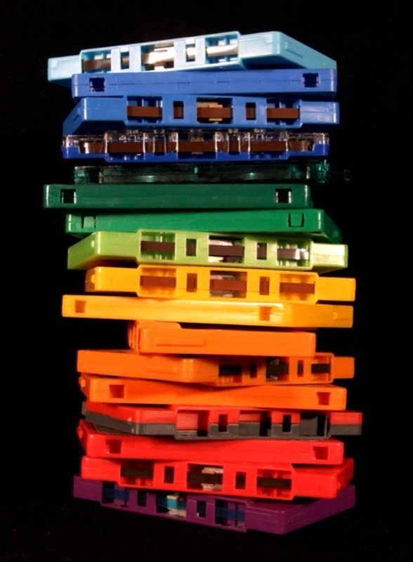 A stack of rainbow-colored cassette tapes.